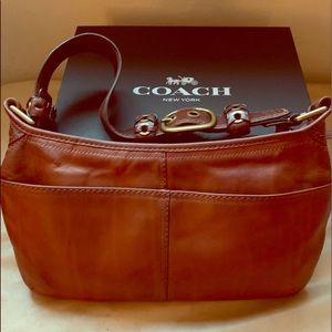 Beautiful COACH bag. Like new. Strap adjusts.